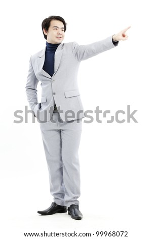 Businessman pointing at his future on white background - stock photo