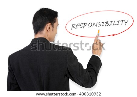 "Businessman pointing at ""Responsibility"" handwritten text on white board with his pen"