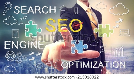 Businessman pointing at SEO (search engine optimization) - stock photo
