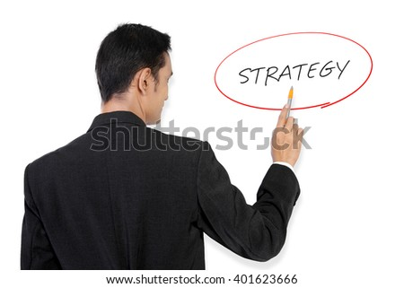 "Businessman pointing at ""Strategy"" handwritten text on white board with his pen"