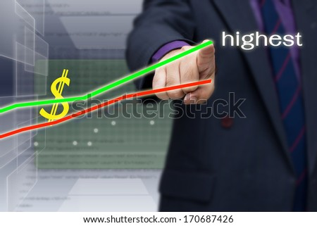 Businessman pointing at the top of the graph with highest word on screen - stock photo