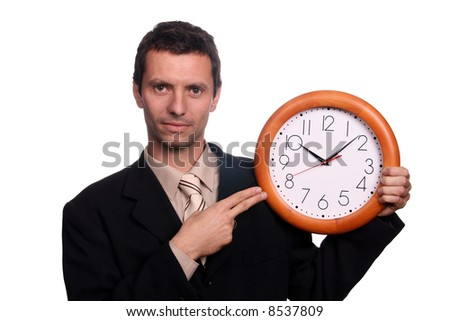 businessman pointing clock - stock photo