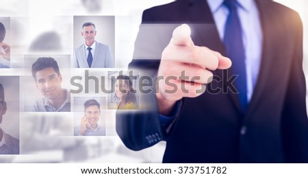 Businessman pointing his finger at camera against white background with vignette