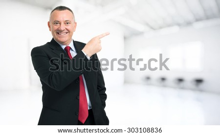 Businessman pointing his finger to the copyspace - stock photo