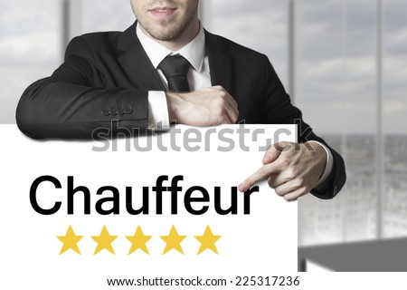 businessman pointing on sign chauffeur golden rating stars - stock photo