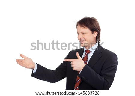 businessman pointing on something in his hand - stock photo