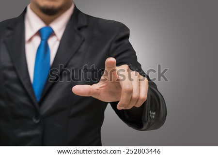 Businessman pointing or touching on gray background