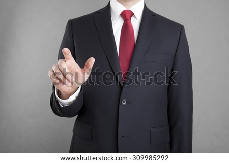 Businessman pointing or touching something  - stock photo