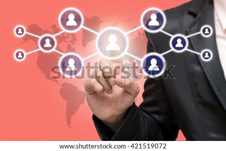 Businessman pointing or touching the Social media symbol on peach color background with world map,Elements of this image furnished by NASA, Business network concept