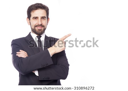 Businessman pointing to copy space, isolated on white background