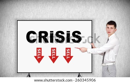 businessman pointing to desk with crisis concept - stock photo