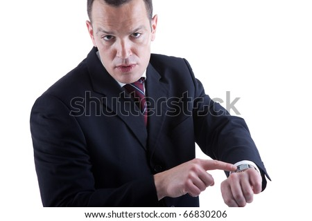 businessman pointing to the watch, isolated on white background. Studio shot. - stock photo