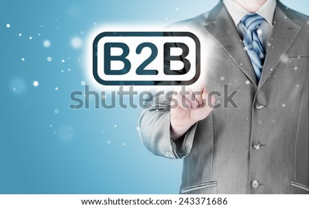 businessman pointing to word B2B, business-to-busines s, written in the foreground - stock photo