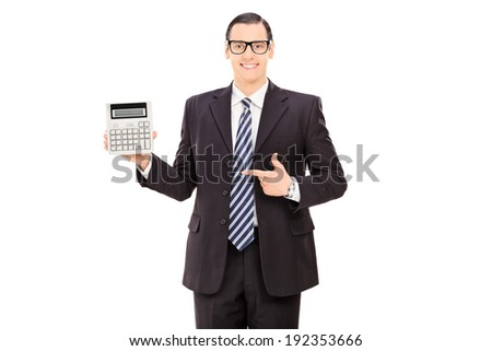 Businessman pointing towards a calculator in his hand isolated on white background