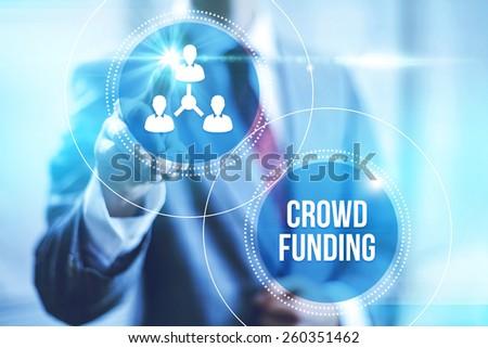 Businessman pointing towards camera selecting crowdfunding , virtual interface - stock photo