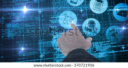 Businessman pointing with his finger against blue matrix and codes - stock photo