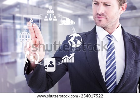 Businessman pointing with his finger against classroom - stock photo