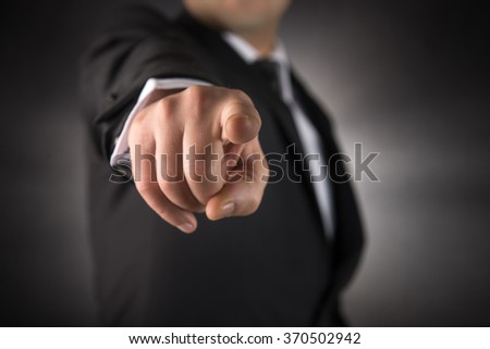 Businessman points his finger at you  - stock photo