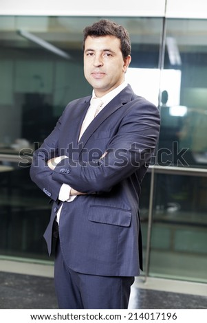 Businessman portrait at the office - stock photo