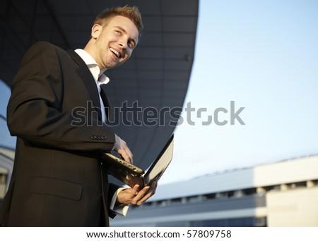 Businessman portrait with laptop - stock photo