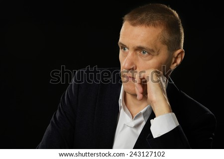 Businessman posing on a black background - stock photo