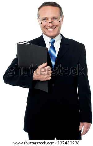 Businessman posing to camera holding report files