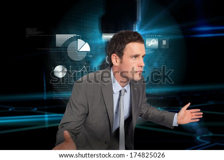 Businessman posing with hands out against doorway on technological black background