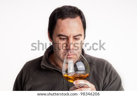 Businessman pouring  a glass of whiskey - stock photo
