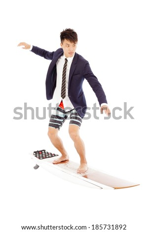 businessman practice surfing pose - stock photo