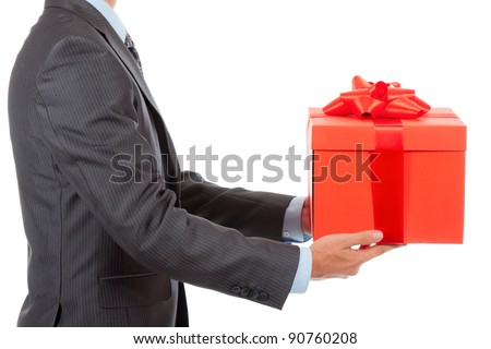 Businessman present red gift box with ribbon bow, side view, isolated over white background. - stock photo