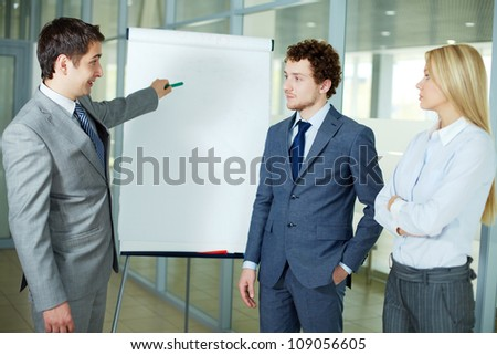 Businessman presenting a new project to colleagues