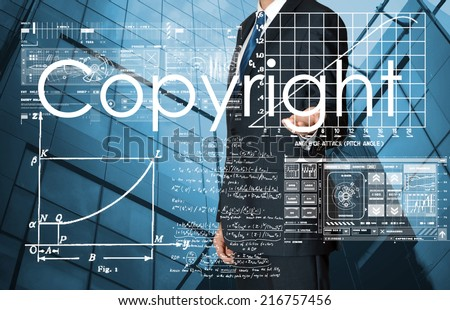 businessman presenting Copyright text and graphs and diagrams with skyscraper in background - stock photo
