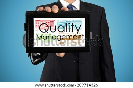businessman presenting something on tablet - Quality management - stock photo