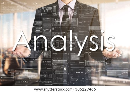 Businessman presenting text Analysis on virtual screen. He is in the office - stock photo