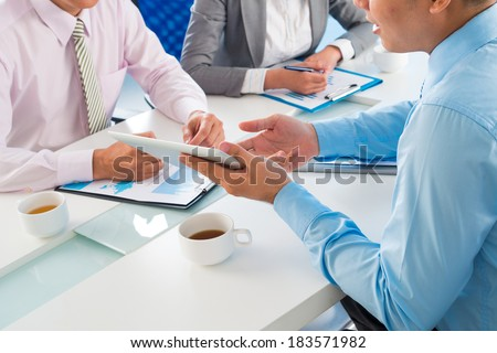 Businessman presenting to his colleagues strategy of company's development  - stock photo