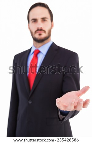 Businessman presenting with his hand on white background - stock photo