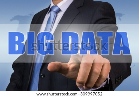 businessman press big data button from touch screen interface - stock photo