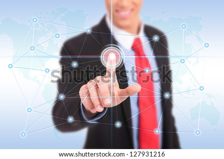 businessman press business world connections buttons - stock photo