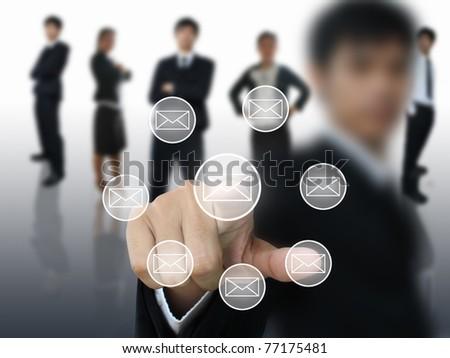 Businessman press envelope button - stock photo
