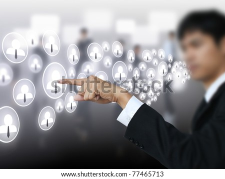 Businessman press social business button - stock photo