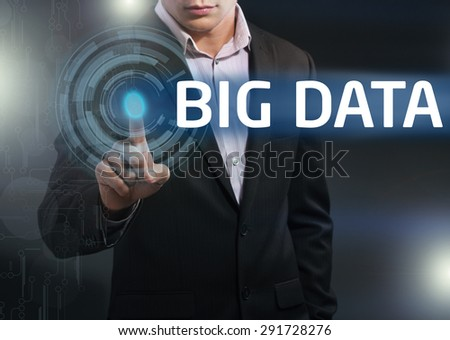 Businessman presses button big data on virtual screens. Business, technology, internet and networking concept. - stock photo