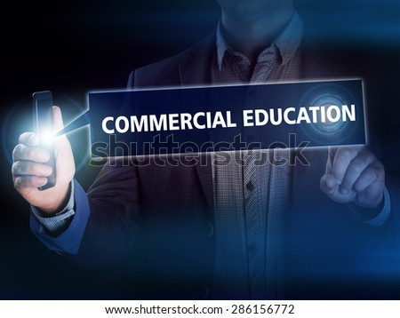 Businessman presses button commercial education on virtual screens. Business, technology, internet and networking concept. - stock photo