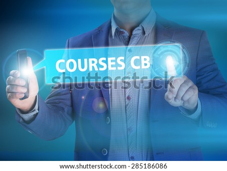 Businessman presses button courses cb on virtual screens. Business, technology, internet and networking concept. - stock photo