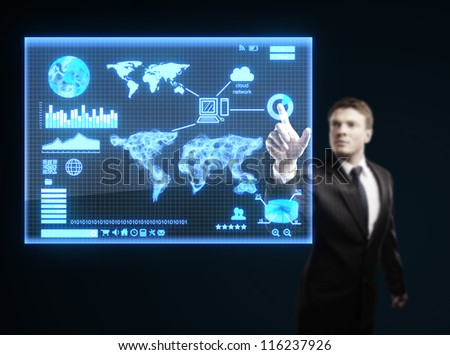 businessman presses button on interface - stock photo