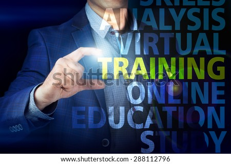 Businessman presses button  training on virtual screens. Business, technology, internet and networking concept. - stock photo