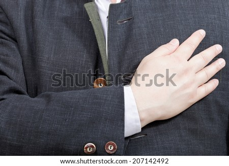 businessman presses his hand to heart - hand gesture isolated on white background - stock photo
