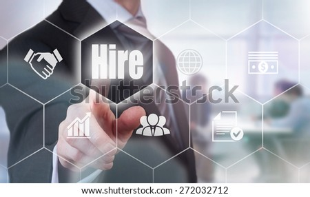 Businessman pressing a Hire concept button. - stock photo