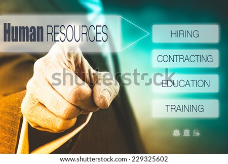 Businessman pressing a Human Resources concept button. - stock photo