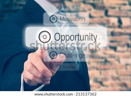 Businessman pressing a Opportunity concept button. Instagram Styling Applied. - stock photo