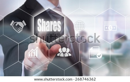Businessman pressing a Shares concept button. - stock photo